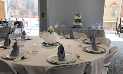 Socially Distanced Wedding Venue Setup With Cake in Background